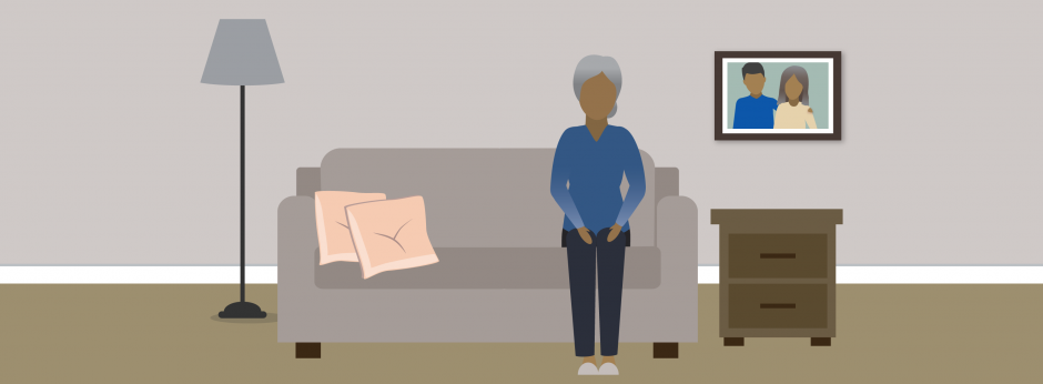 older woman sitting alone on couch